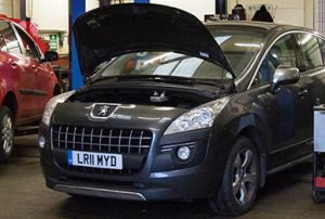 peugeot with hood up